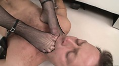 Gorgeous brunette gets some foot service while she rides a dick