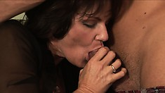 MILF with juicy tits gets some oral action from her young prey