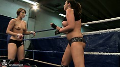 Busty brunette makes a petite chick into her bitch in the ring