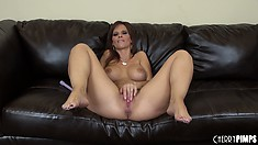 Syren De Mer opens her painted lips to suck on a long black rod