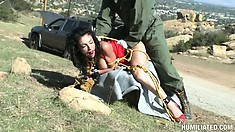 He ties up the pretty Latina lady in the desert and stuffs a ball gag in her mouth