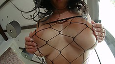 Claudia is a busty brunette babe in a slutty fishnet bodysuit ready for action