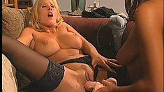 Chelsea and Zana are on the couch licking and toying moist holes