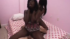 Two lovely black girls please each other and have a white stud pounding their cunts