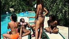 By the pool, four ebony beauties bring their lesbian fantasies to the light of day