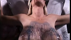 Hot blonde with huge tits gets punished by her sexy mistress