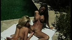 Hot brunette and her lesbian blonde lover make love outdoors