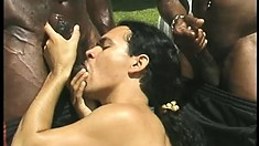 Horny cocksucker has his lips taking care of two huge black cocks