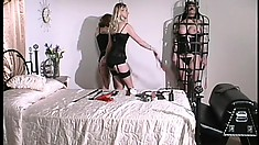 Evil seductress in black dress Erzsbet wants to spank her sex slave
