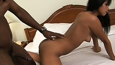 Black man gets behind a tight Asian cutie to penetrate her deep