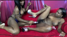 Two exciting black lesbians drive each other's wet pussies to pleasure