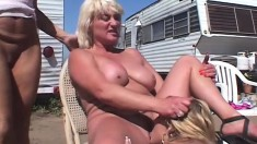 Lesbians out camping can't hold back and fuck each other outside
