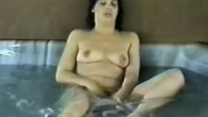 Two luscious mature ladies make each other cum hard in the hot tub