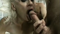 Blonde MILF Kathy Jones gets spit roasted in an intense threesome