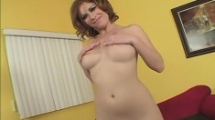 Gorgeous redhead with a divine ass has a black dick taking her pussy to orgasm