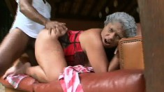 Black granny in a red corset gets pounded by a young thug's dong