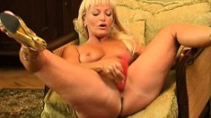 Flawless blonde lady Darina drives a dildo in and out of her wet pussy