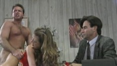Two horny dudes fuck a young insatiable coquette in the office