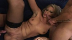 Slutty blonde in black stockings Vanessa gets nailed hard by two guys