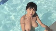 Beautiful Oriental girl Jenny reveals her fantastic body in the pool