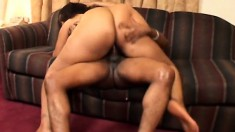 Sultry ebony woman with a big round booty goes crazy for a black pole