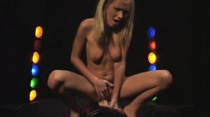 Enticing blonde with lovely tits rides the sybian and finds pleasure