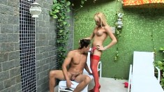 Adorable blonde tranny in red stockings fulfills her anal fantasies