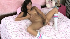 Sexy little Alliyah Sky sticks her dildo in her shaved, slick slit