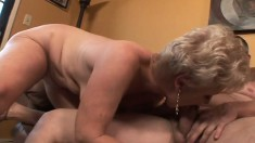 Short haired granny with big breasts worships and rides a long shaft