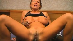 Buxom cougar in heat buries a huge black stick deep in her narrow ass