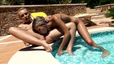 Two enchanting blonde lesbians making each other cum hard by the pool