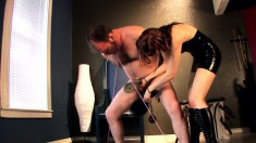 Horny red-haired babe spanks and ties up a guy's manhood and balls