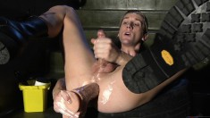 Attractive boy spreads his legs and pleases his ass with huge dildos