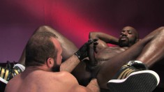 Attractive black stud has a sexy white guy fisting his tight anal hole