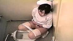 Western nurse and her vagina in a bathroom play. Hidden