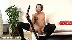 Crazy brunette Hally plays with her pussy and brings out her vacuum