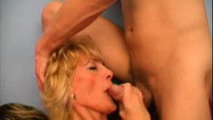 Big breasted mature lady has two young studs pounding her needy peach