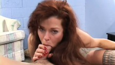 Lusty redhead lady is eager and willing to satisfy two big dicks