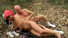 Horny granny sucks a big cock and enjoys a hard pounding in the forest