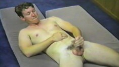 Gay Hunk Lies On His Back And Jerks Off His Long Shaft For The Camera