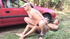 Experienced gay dude has a young stallion drilling his butt outside