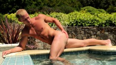Jacque Johnson enjoys the sun on his skin and jerks off his huge cock