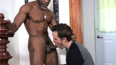 Ripped black DILF enjoys getting his boner worked by a white dude