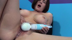 Big breasted cougar in heat Krissy Lynn pleases herself with sex toys