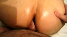 Perfectly round ass gets oiled and injected