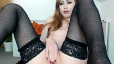 Solo asian hoe in stockings toys and fingers her pussy