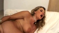 Busty blonde milf in lingerie does blowjob in bedroom