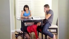 MILF stepmom sucks stepsons cock from beneath the table
