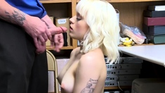A cute blonde shoplifter sits on a hard cock on CCTV