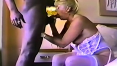 Hot blonde in sexy lingerie having interracial sex